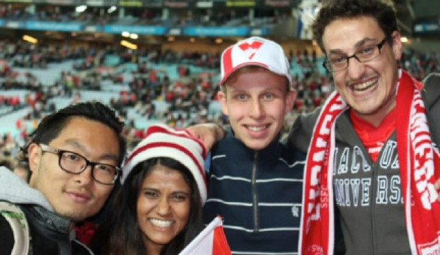 International students enjoy a night at the footy
