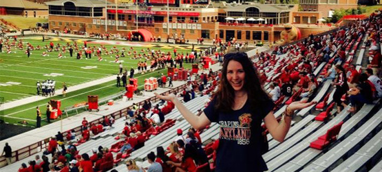 Macquarie University student Courtney West enjoys a game of American football in Byrd Stadium at the University of Maryland.