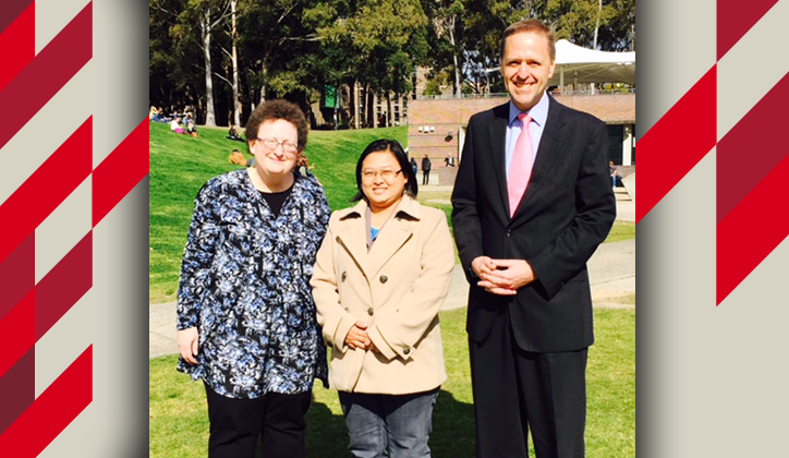 Visiting Myanmar student Wah Wah Aye Khine (centre) with Macquarie University Chief Operating Officer Dr Paul Schreier (right) and University Librarian JoAnne Sparks (left).